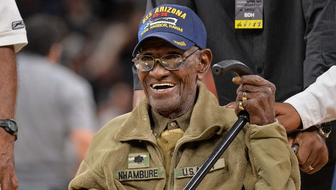 "FILE - In this March 23, 2017, file photo, Richard Overton leaves the court after a special presentation honoring him as the oldest living American war veteran, during a timeout in an NBA basketball game between the Memphis Grizzlies and the San Antonio Spurs.  The family of Richard Overton says Social Security and banking account numbers for the 112-year-old Austin man were used to make seven withdrawals over the past several months. Cousin Volma Overton declined to say how much was stolen but said it was a ""significant amount of money.""  He says the money was used to purchase savings bonds. A police report was filed Friday, June 30, 2018.   (AP Photo/Darren Abate, File)"