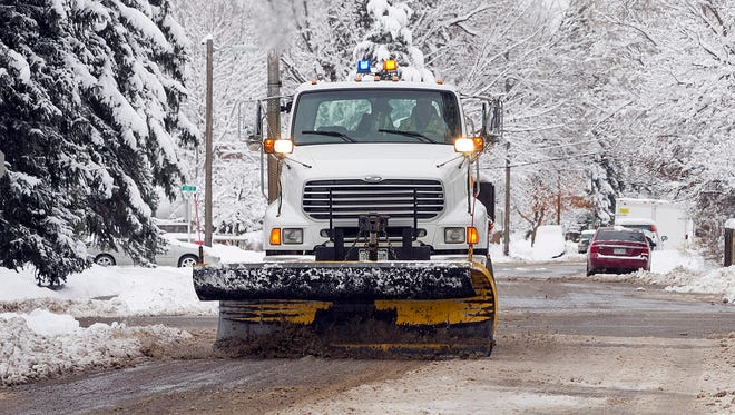 A city plow clears snow along in Durango, Colorado, after a winter storm swept through the region in December 2015.