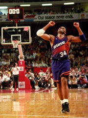 Charles Barkley celebrates during a triple-overtime