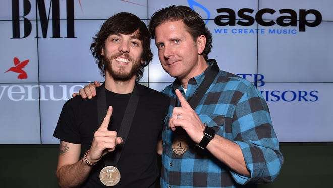 """Chris Janson, left, and Chris Dubois attend the No. 1 party for """"Buy Me A Boat"""" on Tuesday at BMI in Nashville."""