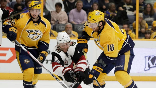 Arizona Coyotes defenseman Zbynek Michalek (4), of the Czech Republic, tries to block a shot by Nashville Predators right wing James Neal (18) during the second period of an NHL hockey game Monday, March 20, 2017, in Nashville, Tenn.