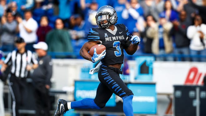 Memphis receiver Anthony Miller ( left) scrambles past the ECU defense for a 89 yard touchdown catch during first quarter at the Liberty Bowl Memorial Stadium in Memphis, Tenn., Saturday, November 25, 2017.
