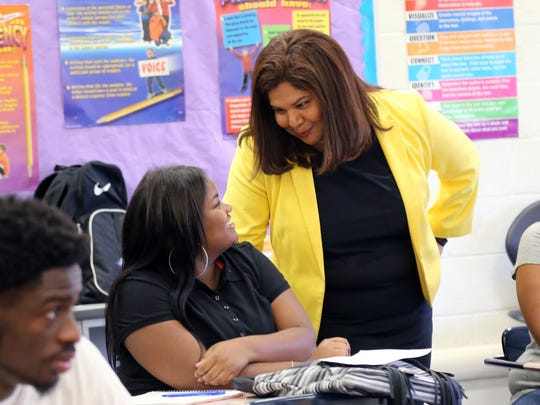 EAA district  chancellor Veronica Conforme talks to Lexus Sampson,17, a senior in the English Language Arts class  at Henry Ford High School in Detroit on the first day of school on Tuesday, Sept. 8, 2015.