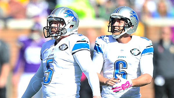 Sam Martin, right, with Matt Prater during a game against the Vikings last October.