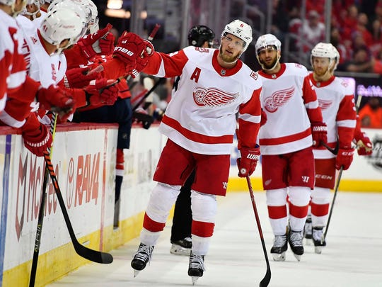 Red Wings left wing Justin Abdelkader (8) is congratulated