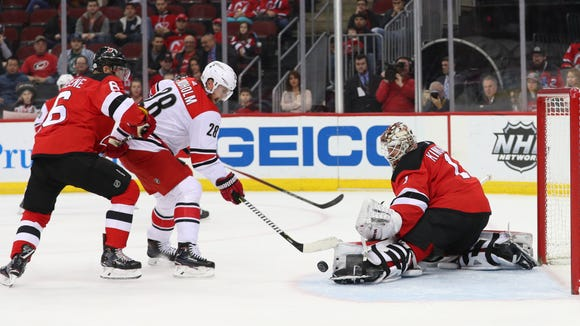 New Jersey Devils goaltender Keith Kinkaid (1) makes a save on Carolina Hurricanes center Elias Lindholm (28) during the first period at Prudential Center on Thursday, Feb. 15, 2018 in Newark.