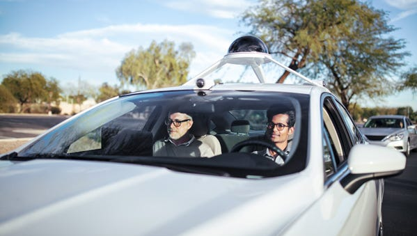 Two Intel employees test out a self-driving car in the southeast Valley.