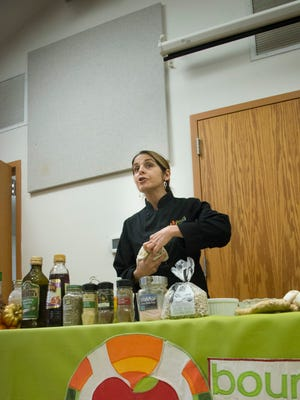 Bounty & Soul founder Ali Casparian leads a cooking class for the organization's clients last Thanksgiving.
