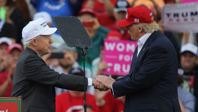 Sen. Jeff Sessions speaks with President-elect Donald Trump at Ladd-Peebles Stadium in Mobile, Ala., on Dec. 17, 2016.