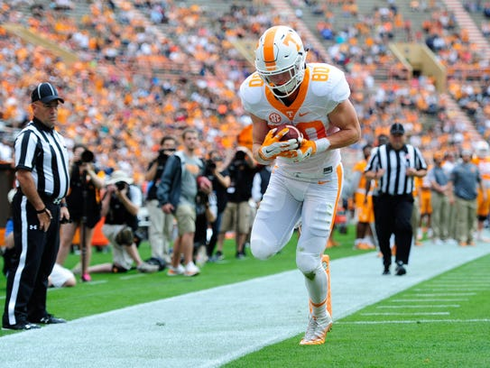 Tennessee tight end Eli Wolf scores during the Orange & White Game on April 22.