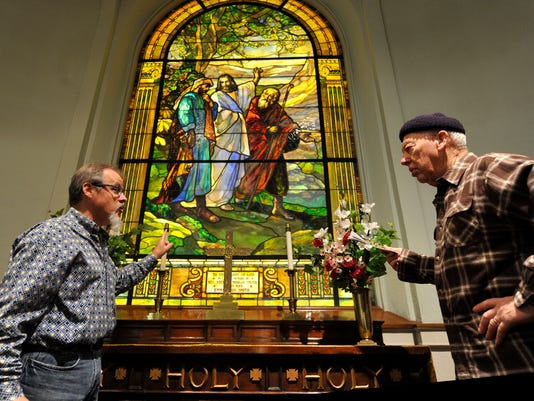 Terrence Dutchie Downs, left, discusses the Rudy art glass at First Moravian Church with Bill Kopp of Hanover during a walking tour in York city on Saturday, Oct. 17, 2015.  Jason Plotkin - York Daily Record/Sunday News