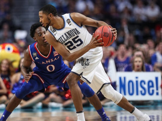 Villanova guard Mikal Bridges is defended by Kansas guard Marcus Garrett during the national semifinal at the Alamodome in San Antonio, Saturday, March 31, 2018.