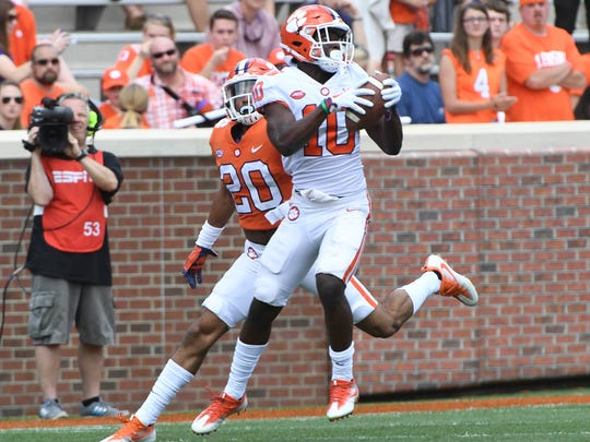 Clemson wide receiver Derion Kendrick (10) catches a pass near Clemson defensive back LeAnthony Williams (20) during the 1st quarter of the spring game in Memorial Stadium in Clemson on Saturday, April 14, 2018.