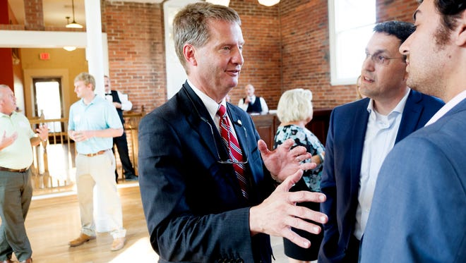 Knox County Mayor and congressional candidate Tim Burchett chats with Knoxville News Sentinel President Frank Rosamond during the Knoxville News Sentinel's USA Today Network - Tennessee launch celebration and welcome for News Sentinel President Frank Rosamond at The Southern Depot in Knoxville, Tennessee on Tuesday, August 8, 2017.