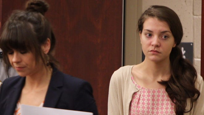 Shayna Hubers, right, enters Campbell County Circuit Court on Friday, the fifth day of her murder trial in the shooting death of Ryan Poston.