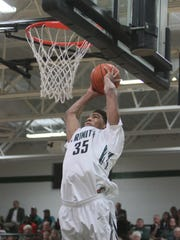 Trinity's center, Raymond Spalding (35) dunks the ball in the first half of play against Jeffersonville. December 2, 2014.