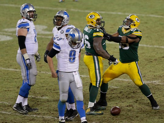 Green Bay Packers defensive end Datone Jones, right, celebrates with Mike Daniels after Daniels sacked Detroit Lions quarterback Matthew Stafford (9) late in the fourth quarter.