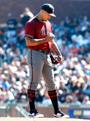 Arizona Diamondbacks pitcher Taijuan Walker looks down after walking home a run during the fifth inning of a baseball game against the San Francisco Giants, Sunday, Sept. 17, 2017, in San Francisco.