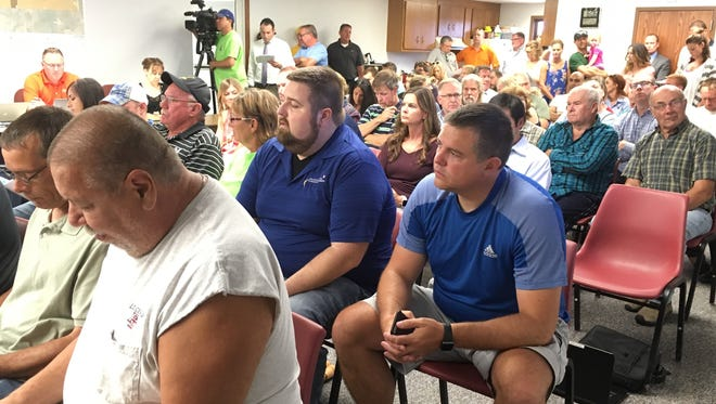 Ledgeview residents concerned about a proposal to install a manure-holding area at a local dairy farm jam a public hearing at the town hall on Aug. 7