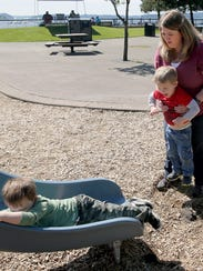 Tammy Harder holds her Marcus, as enjoys the playground