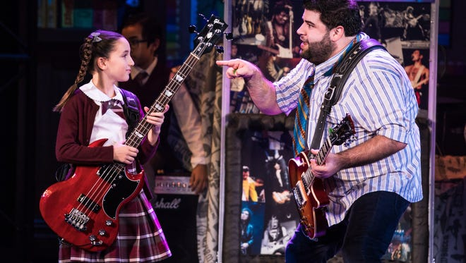 """Theodora Silverman takes a pointer from Rob Colletti in """"School of Rock: The Musical"""" at the Marcus Center."""