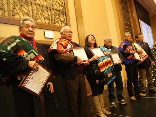 From left, former Navajo Nation Chairman Peter MacDonald, former President Peterson Zah, Sheena Hale, who represented her father President Albert Hale, President Kelsey Begaye, President Joe Shirley Jr. and President Russell Begaye stand for a photo. The former leaders were honored during the Navajo Housing Authority winter staff meeting on Dec. 22 at the Twin Arrows Navajo Resort Casino near Flagstaff, Ariz.