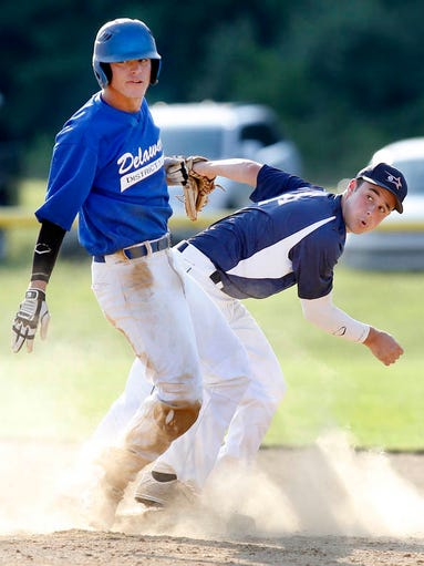 Delaware District 1's Dakota Graham (left) and Pennsylvania District 28's Philip Matranga watch as Matranga's throw is in time to complete a double play in Pennsylvania's 5-0 win, securing a berth in the Big League World Series, Thursday, July 17, 2014 at Schutte Park in Dover.