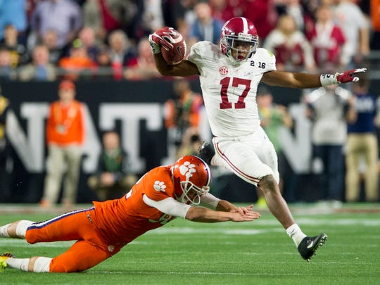 Alabama running back Kenyan Drake (17) breaks free for a touchdown on a kick return against Clemson in the College Football Playoff Championship Game on Monday January 11, 2016 at University of Phoenix Stadium in Glendale, Az.