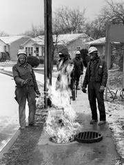 Employees of the Nashville Gas Co. scrutinize a fire