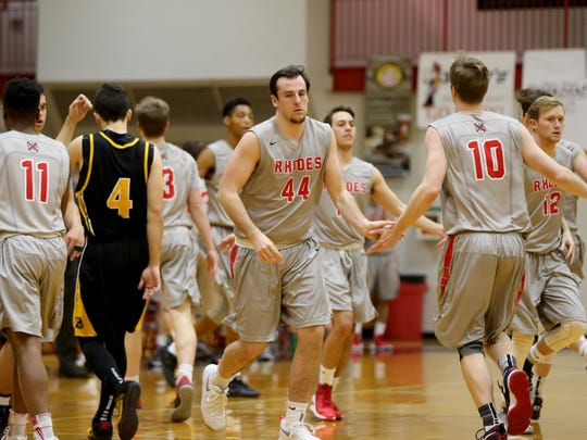 The Rhodes basketball team makes substitutions in groups of five as part of their fast-paced style of play.