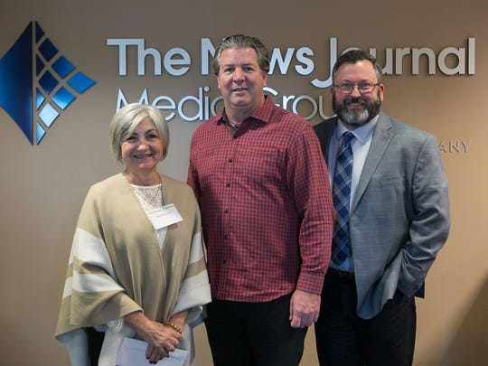 Donna Fierro with Reading Assist and Matt Sullivan (right) receive a Gannett Foundation Grant from Thomas Donovan, President/Publisher and Northeast Regional President of Gannett East Group.