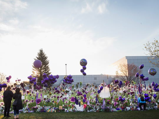 Fans continue leaving purple-themed mementos at Prince's