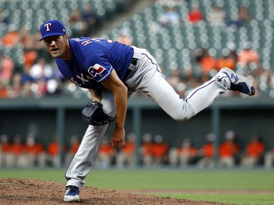 Texas Rangers starting pitcher Cole Hamels throws to the Baltimore Orioles during a baseball game, Friday, July 13, 2018, in Baltimore. (AP Photo/Patrick Semansky)