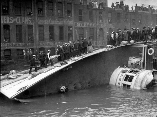 The S.S. Eastland lies on its side in the Chicago River