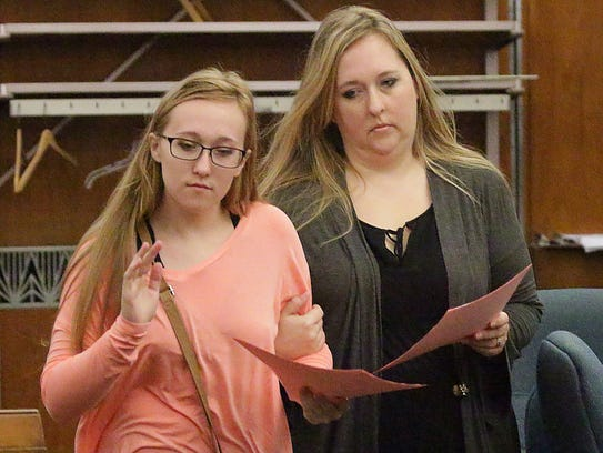 Breanna Mikula, left, and Chisty Tuchel, right, leave