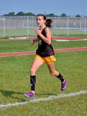 Buckeye Valley freshman cross country runner Chloe Dawson runs to the girls win at the Baron Blast.