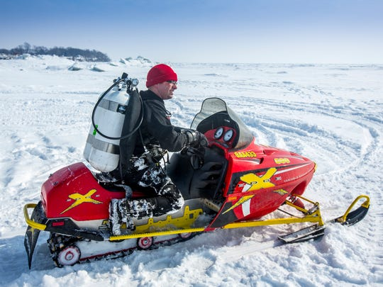Photographer Andy Morrison shuttles his dive gear out