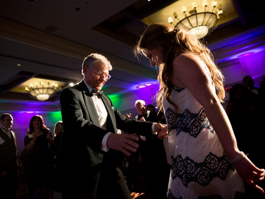 Tom Monaghan, founder of Ave Maria University, dances