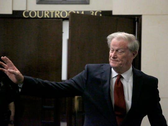 Florida State University President John Thrasher leaves the courtroom at the Leon County Courthouse where a grand jury is investigating the death of fraternity pledge Andrew Coffey Monday.