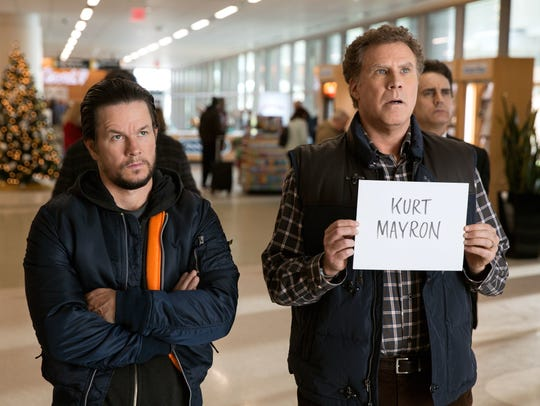 Mark Wahlberg, left, as Dusty and Will Ferrell as Brad, wait at the airport for their fathers in 'Daddy's Home 2.'