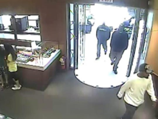 Three men entered Tourneau, smashed a display case with a hammer and stole seven watches worth a total of about $315,000.