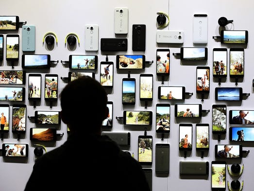 An attendee looks at a display of new Google devices