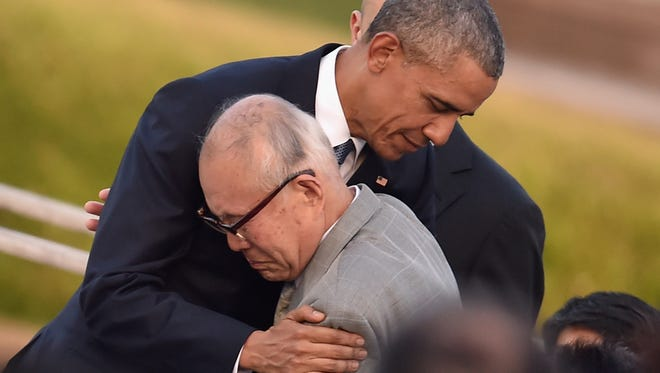 U.S. President Barack Obama embraces an atomic bomb victim May 27, 2016, at the Hiroshima Peace Memorial Park in Hiroshima, Japan. It is the first time a U.S. president made an official visit to the site where the atomic bomb was dropped in the end of World War II on Aug. 6, 1945.