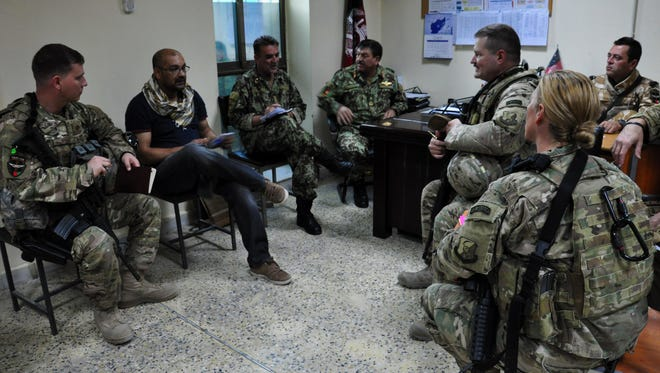 Train, Advice, Assist Command – Air coalition advisors meet with Afghan air force wing operations center and Afghan command and control center leaders Aug. 31, 2015. This was the first Afghan-led exercise scenario coordinated and planned between the Kabul WOC and ACCC.