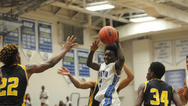 Stephen Decatur's sophomore Ja'Ron Johnson dishes after a drive against Wicomico on Tuesday in Berlin.