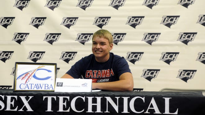 Sussex Tech's Nathan Hanenfeld signs his national letter of intent to Catawba College in North Carolina.