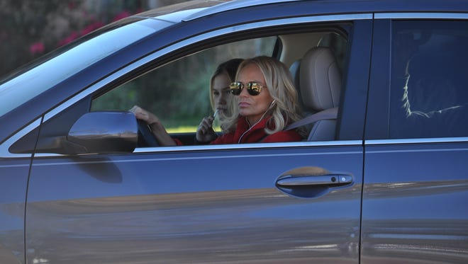 "Kristin Chenoweth drives around an Alexandria neighborhood with Olivia Holt in the passenger seat on Tuesday as they are filmed for a scene in the movie ""Class Rank,"" which is being filmed in Central Louisiana this month."