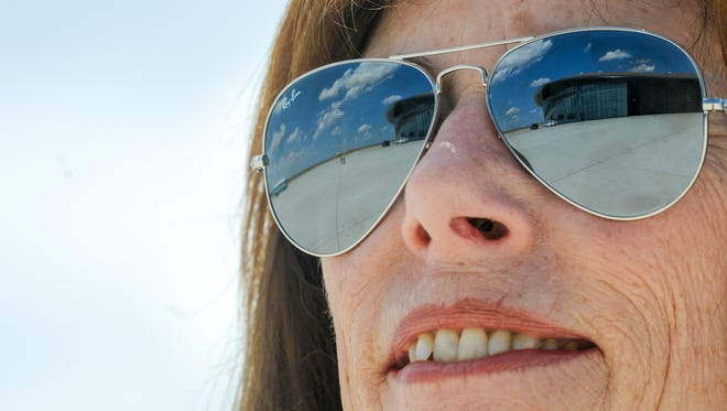 Spaceport America Chief Executive Officer Christine Anderson, looks on as the reflection of the spaceport is reflected in her glasses in July of 2009.