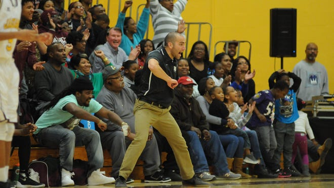 Snow Hill's coach Byron Arenella tells the Eagles to get back on defense after an Eagle nailed a huge shot against Washington High School on Thursday night in Princess Anne, MD.