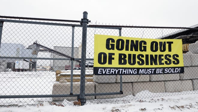 A sign declaring the closure of Port Huron Building Supply is hung for passing motorists Monday, Feb. 15, 2016 in Port Huron.